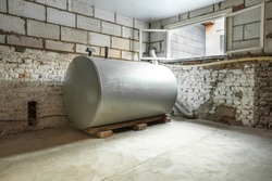 in a separate room in a old building, there is a heating oil tank