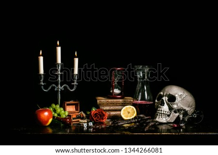 In a vanitas still life symbolism plays an important role. Items such as a skull, a candle, decayed books, fruits, soap bubbles, smoke, clocks, musical instruments and hourglasses are symbols of the t #1344266081