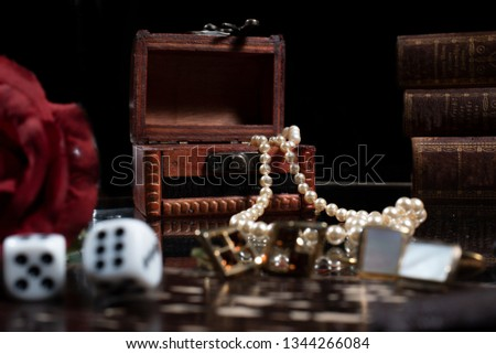 In a vanitas still life symbolism plays an important role. Items such as a skull, a candle, decayed books, fruits, soap bubbles, smoke, clocks, musical instruments and hourglasses are symbols of the t #1344266084