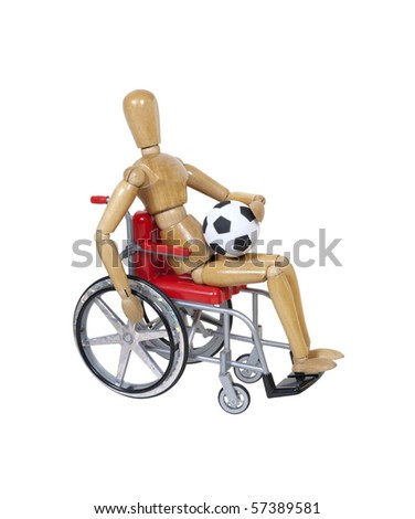In a wheelchair holding a soccer ball - path included