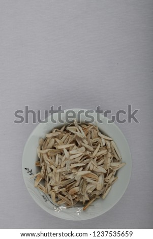 in a white container, full and empty sunflower seeds #1237535659
