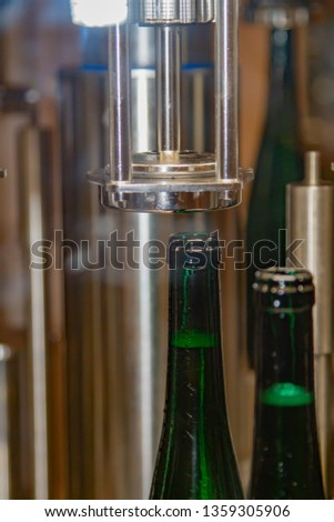 in a winery wine gets bottled automatically in a filling station