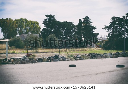 In an abandoned area piled in piles used car tires near the resort village (Rhodes, Greece)