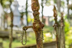 In an old cemetery there is a tomb with rusted iron poles