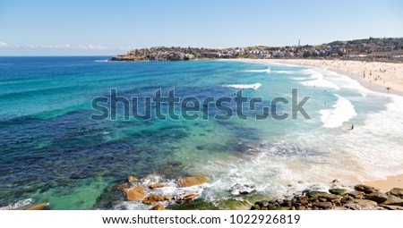 in  australia  the beach tourist and surfer #1022926819