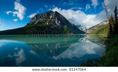 In Banff National Park, Alberta, Canada, a beautiful reflection of the mountain peaks around Lake Louise.