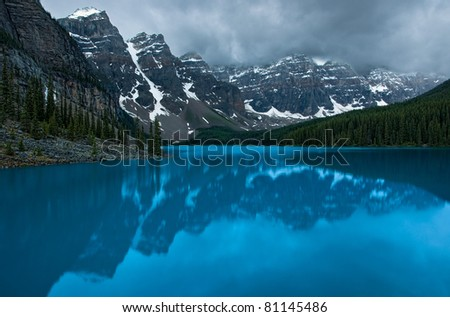 In Banff National Park, Alberta, Canada, Moraine Lake and surrounding mountains (Valley of Ten Peaks) during a gloomy sunrise.