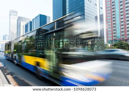 In Beijing, China, a bus is speeding through the central business district. #1098628073