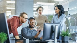 In Busy Corporate Office Team of Diverse Young Creative People Work on a Problem Solution. Collectively They Try to Help Coworker to Solve Problem.
