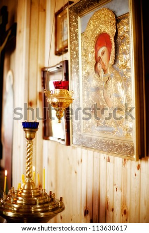 in church candles and lamp beside the icon - stock photo
