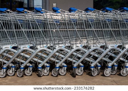 in front of a supermarket shopping carts are ready for customers