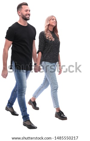 in full growth. young couple walking together