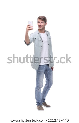 in full growth.young man taking selfie