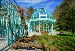 In Georgia the City of Borjomi. In its beautiful public park an iron turquoise pavillon. Surrounded by old trees and old wisteria plants.