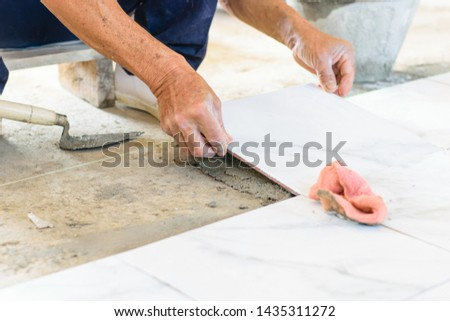 In home construction I am laying tile on the floor material is cement, tiles, buckets, hammers, paving the lap. The commitment, expertise To operate successfully, with next. #1435311272