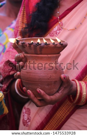 in India, in mud pot burn some cotton threat light by oil for giving light in heaven die old people of family.