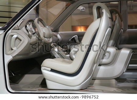 in interior of the white car a rudder armchairs and all covering of white color stock photo. Black Bedroom Furniture Sets. Home Design Ideas
