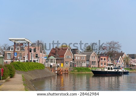 In little village Weesp a boat is waiting for opening the bridge
