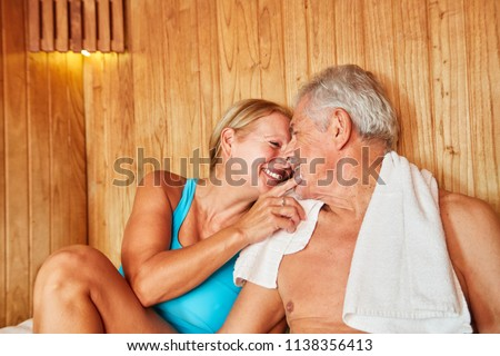 In love senior couple sitting together in the sauna at the Wellness Hotel