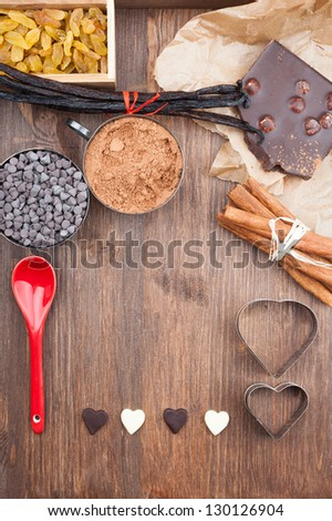 In love with chocolate. Ingredients for baking chocolate on a dark wooden background