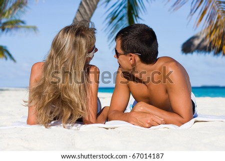 In love young couple on a tropical beach