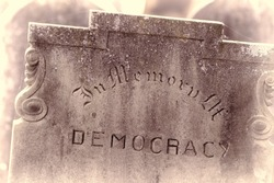 In Memory of democracy. Brexit referendum and USA presidential election concept image. Gravestone with the word democracy Political madness and modern politics gone bad. Failed democracy chaos concept