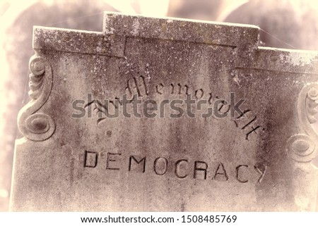 In Memory of democracy. Brexit referendum and USA presidential election concept image. Gravestone with the word democracy Political madness and modern politics gone bad. Failed democracy chaos concept Stock fotó ©