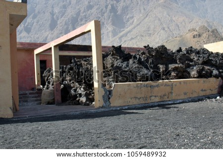 In November 2014, the Pico de Fogo volcano began to shed a glowing lava. Fortunately, no one was injured. Lava defended the houses and lots of it was already full. Fogo island, Cape Verde #1059489932