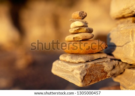 In perfect balance - these carefully laid, sun-kissed, stones epitomise where we all want to be.