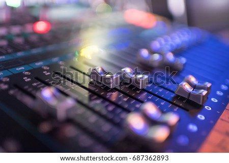 In selective focus of Mixes the track sound equipment in the nightclub at party.