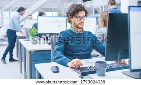In the Big Busy Corporate Office Businessman Works on Desktop Computer, Around Him Businesspeople and Experts Working with Clients, Having Discussions and Analysing Statistics