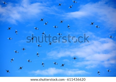 In the blue sky a lot of aircraft #611436620