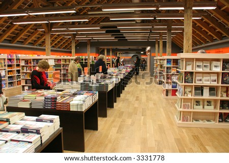 In the book store (shelves of books)