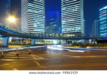 In the 2012 China Shanghai night building traffic light trails