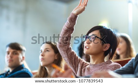 In the Classroom Smart Asian Student Asks Professor a Question. Multi Ethnic Group of Modern Bright Students at the College.