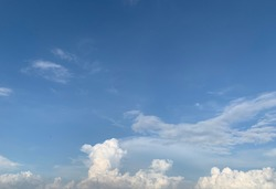 In the clear blue sky there are both Cirrus clouds and beautiful white Cumulus clouds.
