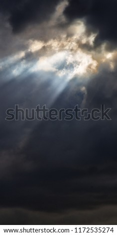in the cloudy sky a ray of light like concept of holy paradise and peace Stock photo ©
