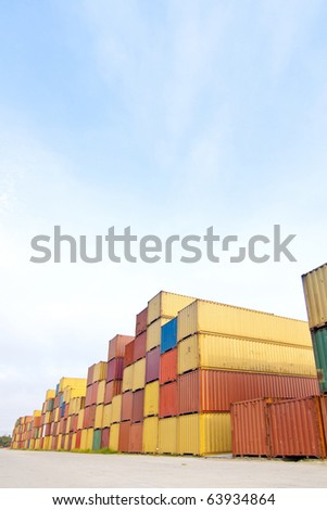 in the container storage area, we can see too much lifting truck and colorful stack under the blue sky