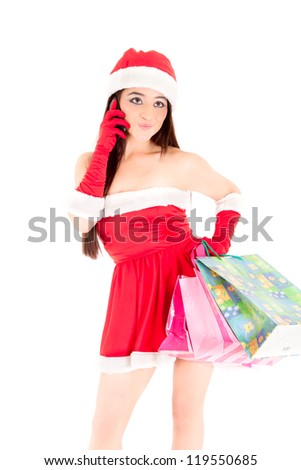 In the digital age Mrs. Santa and her cell phone with shopping bags