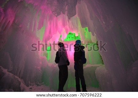 In the hall room Illuminated ice cave with tourist at Snow Festival Sapporo, Hokkaido, japan. #707596222