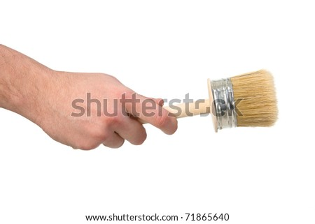 in the hand holding the brush