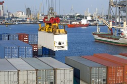 In the harbor of Rotterdam, Netherlands, container vessel being loaded
