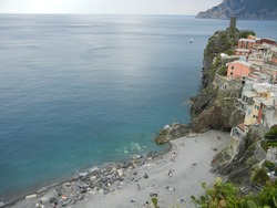 In the Italian National Park of the Cinque Terre, the peninsula with the village of Vernazza and the picturesque beach where you enter through a tunnel in the rock to reach the bay