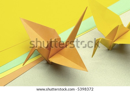 In the Japan, Tsuru origami represents luck, peace, happiness and longevity. - stock photo