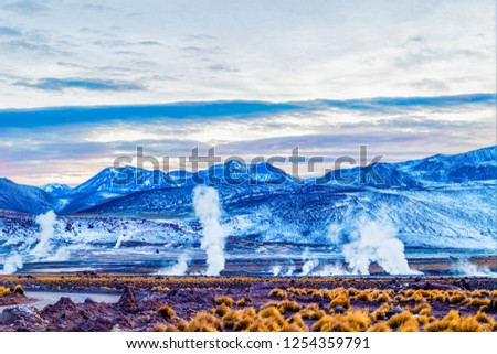 In the morning steam and smoke of the Geysers Del Tatio, mountai