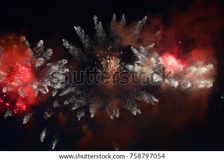 In the night sky fireworks explosions have created a fantastic picture of flying fires.