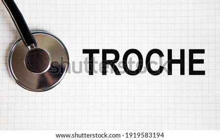 In the notebook tectes TROCHE, next to a stethoscope. Zdjęcia stock ©