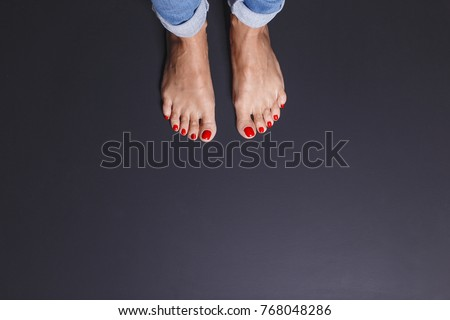 In the picture, female feet as a concept  get out from the comfort zone. There is a lot of space for your text here. The girl is going to take the first step beyond the comfort zone.