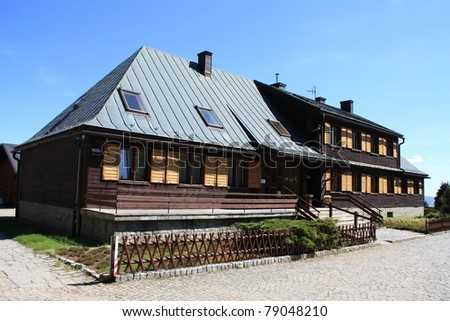 In the Polish mountains can be seen very often made â??â??of wood buildings intended for tourists. - stock photo