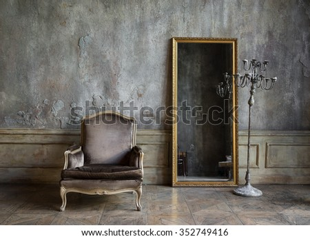 In the room are antique mirror and a chair